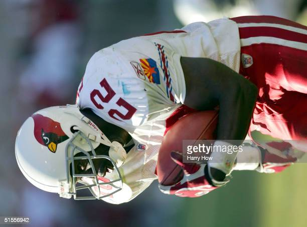 Emmitt Smith of the Arizona Cardinals rushes to the end zone for a touchdown resulting in a 2517 Cardinal win over the Seattle Seahawks in the fourth...