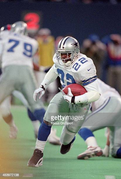 Emmitt Smith of the Dallas Cowboys carries the ball against the New York Giants during an NFL football game November 24 1996 at Giants Stadium in...