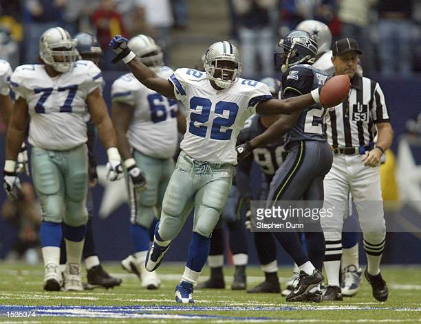 Emmitt Smith of the Dallas Cowboys celebrates breaking the NFL all time rushing record in their game against the Seattle Seahawks on October 27 2002...