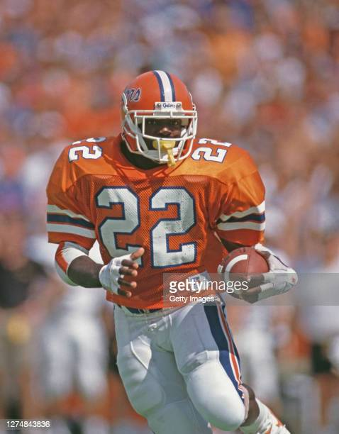 Emmitt Smith, Running Back for the University of Florida Gators runs the ball during the NCAA Southeastern Conference college football game against...