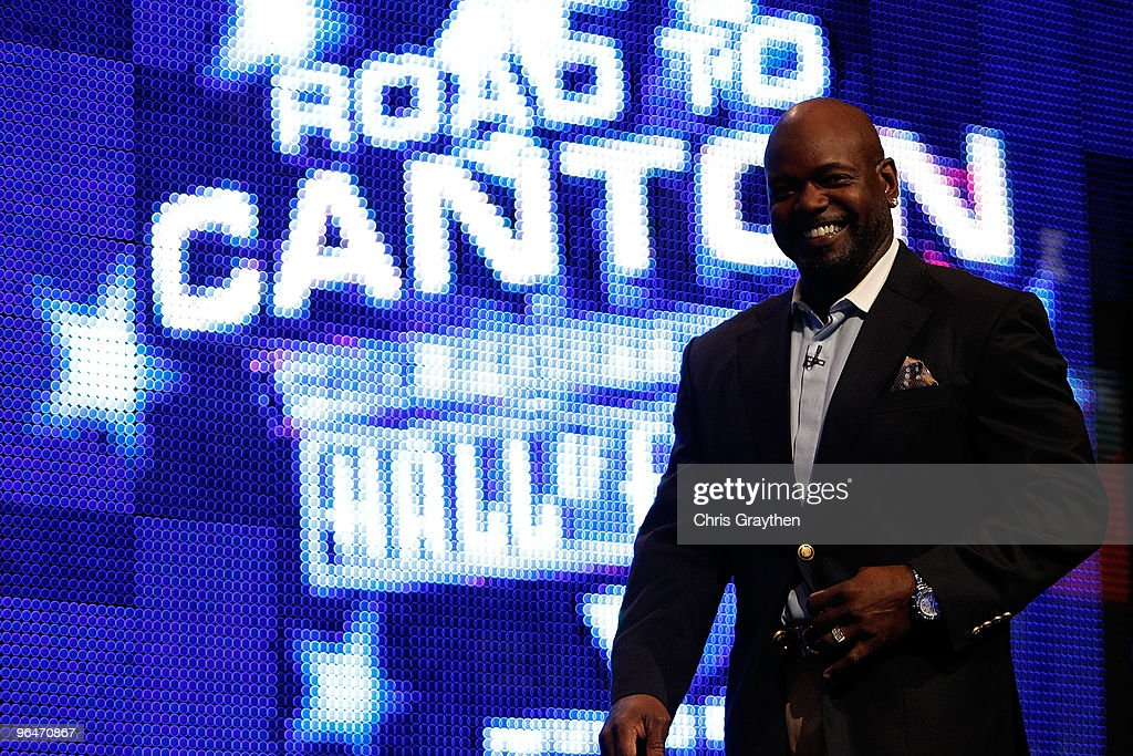 Emmitt Smith smiles as he walks on the stage after being announced as one of the newest enhrinees into the Hall of Fame during the Pro Football Hall of Fame Class of 2010 Press Conference held at the Greater Ft. Lauderdale/Broward County Convention Center as part of media week for Super Bowl XLIV on February 6, 2010 in Fort Lauderdale, Florida.