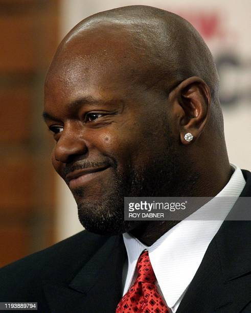 Emmitt Smith the alltime leading NFL rusher smiles as he is introduced to the media as the newest member of the Arizona Cardinals 27 March in Tempe...