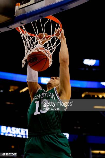 Emmy Andujar of the Manhattan Jaspers dunks the ball against the Louisville Cardinals in the second half during the second round of the 2014 NCAA...
