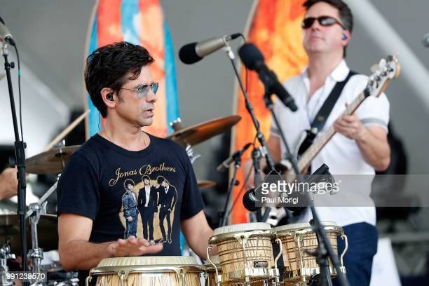 Emmy Awardnominated actor producer and host John Stamos performs with The Beach Boys at the 2018 A Capitol Fourth rehearsals at US Capitol West Lawn...