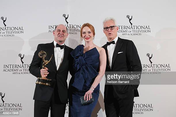 Emmy Founders Award recipient Creator Executive Producer Writer of Mad Men Matthew Weiner poses with his award and presenters Christina Hendricks and...