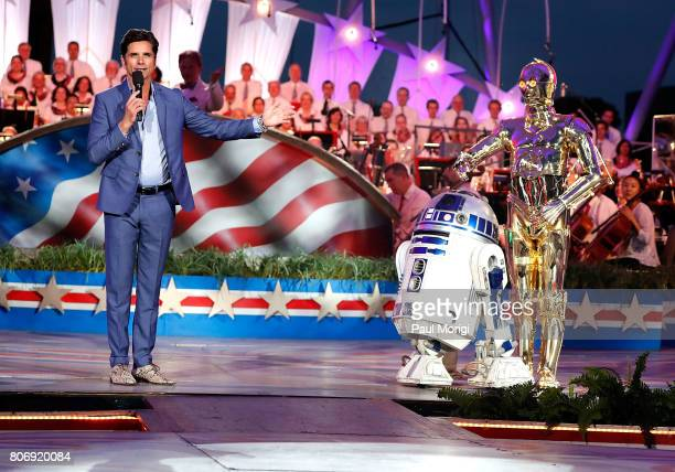 Emmy nominated actor and host John Stamos on stage with Star Wars characters R2D2 and C3PO at A Capitol Fourth Rehearsals at US Capitol West Lawn on...