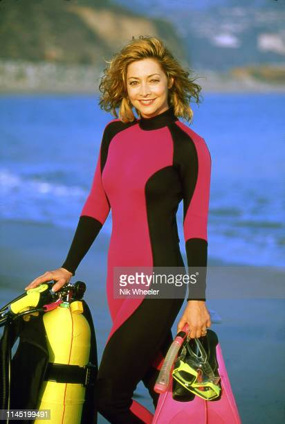 Emmy nominated television and movie actress singer and dancer Sharon Lawrence in scuba diving gear on the beach in Santa Monica California circa 2004