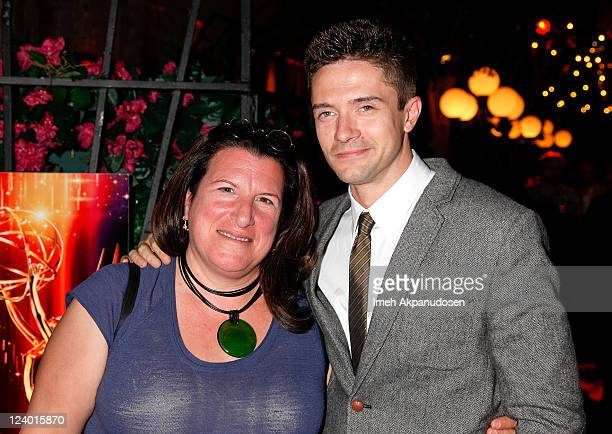 Emmy nominated 'Too Big To Fail' casting director Alexa Fogel poses with actor Topher Grace at the 63rd Primetime Emmy Awards Nominee Reception For...