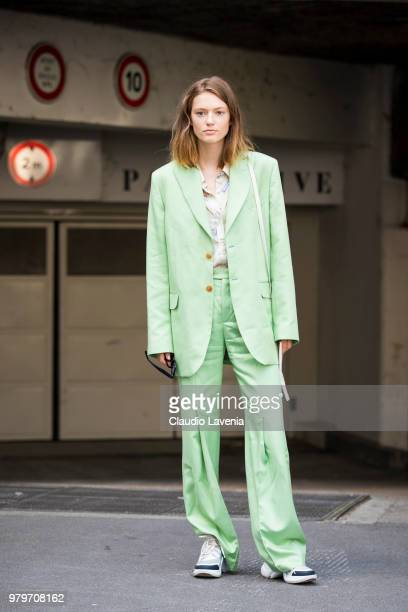 Emmy Rappe wearing green suit and Louis Vuitton sneakers is seen in the streets of Paris before the Acne Studio show during Paris Men's Fashion Week...