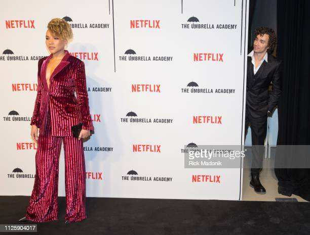 Emmy RaverLampman on the carpet as Robert Sheehan peeks out from behind as he waits for his turn on the carpet Bell TIFF Lightbox hosted a screening...