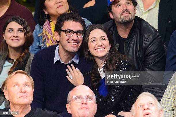 Emmy Rossum and guest attend a basketball game between New York Knicks and the Los Angeles Lakers at Staples Center on March 25, 2014 in Los Angeles,...