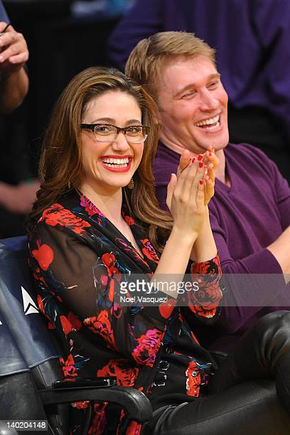 Emmy Rossum and Tyler Jacob Moore attend a basketball game between the Minnesota Timberwolves and the Los Angeles Lakers at Staples Center on...