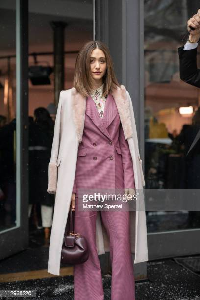 Emmy Rossum is seen on the street during New York Fashion Week AW19 wearing pink suit with taupe coat on February 12 2019 in New York City