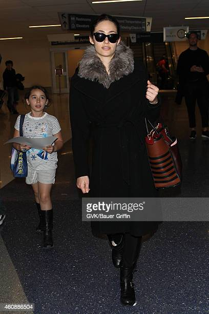 Emmy Rossum seen at LAX on December 28 2014 in Los Angeles California