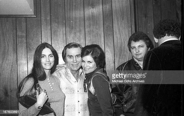 Emmylou Harris and George Jones backstage at a George Jones concert at the Palomino Club on February 29 1981 in Los Angeles California