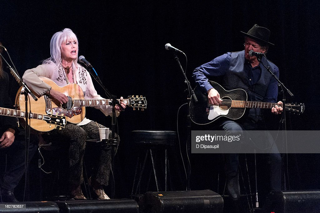 Emmylou Harris (L) and Rodney Crowell perform on stage during the All For The Hall New York concert benefiting the Country Music Hall Of Fame at Best Buy Theater on February 26, 2013 in New York City.