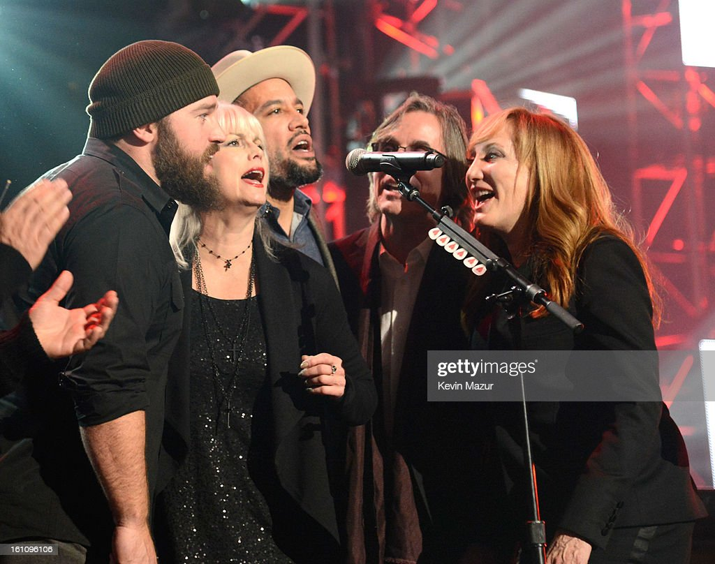 Emmylou Harris, Ben Harper, Jackson Browne and Patti Scialfa perform onstage at MusiCares Person Of The Year Honoring Bruce Springsteen at Los Angeles Convention Center on February 8, 2013 in Los Angeles, California.