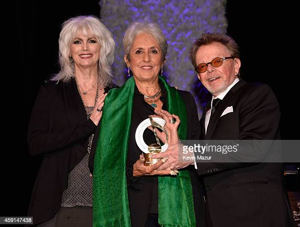 Emmylou Harris Joan Baez and President and Chairman of ASCAP Paul Williams pose onstage at the ASCAP Centennial Awards at Waldorf Astoria Hotel on...