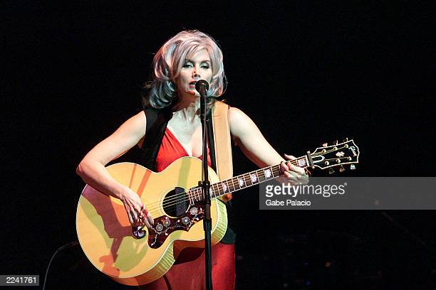 Emmylou Harris on stage performing during the Tibet House Benefit Concert 2001 with artistic director Philip Glass Dana Bryant Emmylou Harris Patti...