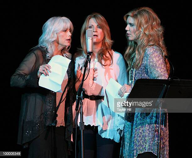 Emmylou Harris Patty Loveless and Allison Krauss perform during the Music Saves Mountains benefit concert at the Ryman Auditorium on May 19 2010 in...