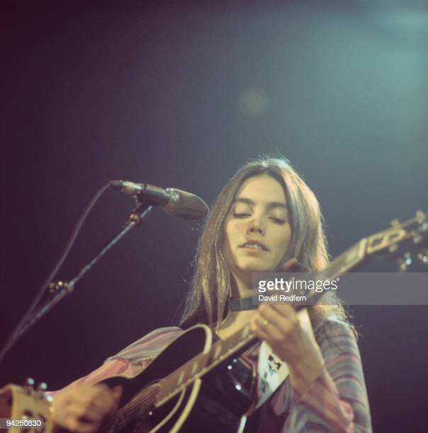 Emmylou Harris performs on stage at the Country Music Festival held at Wembley Arena, London in April 1975.
