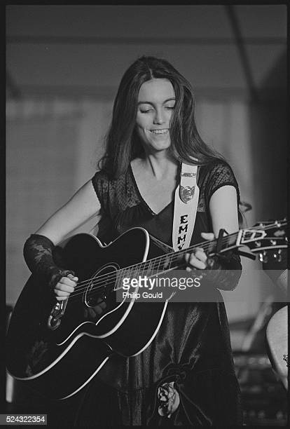 Emmylou Harris Playing an Acoustic Guitar