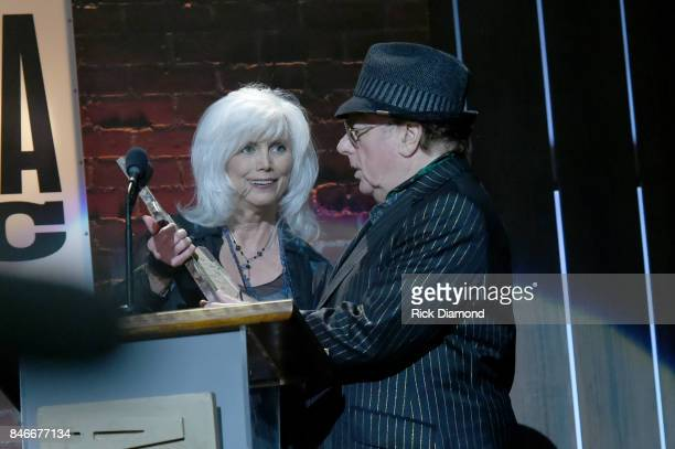 Emmylou Harris presents Van Morrison with the Lifetime Achievement for Songwriter award onstage during the 2017 Americana Music Association Honors...