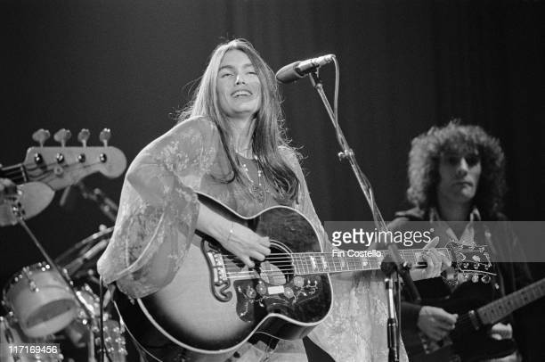 Emmylou Harris US singersongwriter smiling and playing a guitar on stage during a live concert performance at The Dome in Brighton East Sussex...