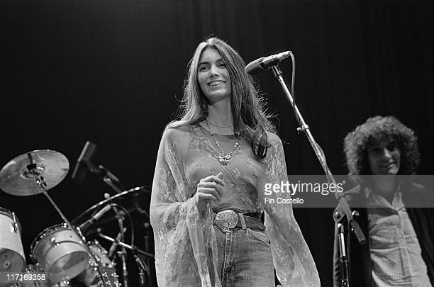 Emmylou Harris, US singer-songwriter, smiling on stage during a live concert performance at The Dome, in Brighton, East Sussex, England, Great...