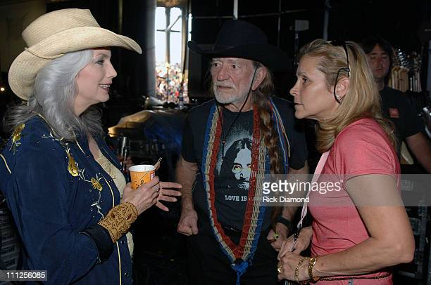 Emmylou Harris Willie Nelson and Annie Nelson during FARM AID 2005 Presented by SILK Soymilk at Tweeter Center in Tinley Park Illinois United States