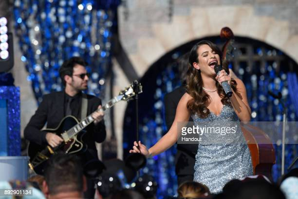 Emmynominated actress and singer Lea Michele performs the holiday favorite 'Let It Snow' from Sleeping Beauty Castle at Disneyland Park in Anaheim...