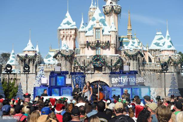 Emmynominated actress and singer Lea Michele performs the holiday favorite Let It Snow from Sleeping Beauty Castle at Disneyland Park in Anaheim...
