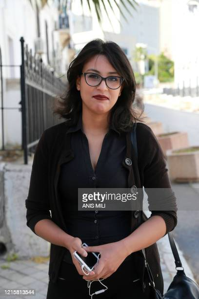 Emna Charki a 27yearold Tunisian charged with offending common decency and incitement to violence arrives at a court in the capital Tunis on May 28...