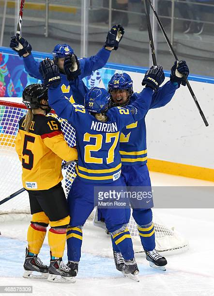 Emna Nordin of Sweden celebrates scoring the first goal in the first period against Germany during the Women's Ice Hockey Preliminary Round Group B...