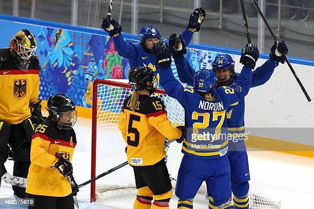 Emna Nordin of Sweden celebrates scoring the first goal with her teammates Erika Grahm of Sweden in the first period against Jennifer Harss of...
