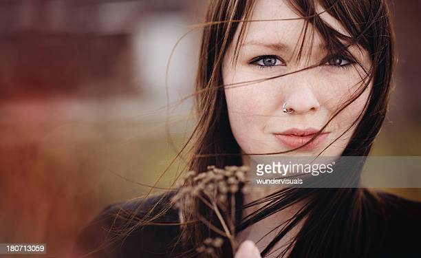 emo girl is holding a dead plant - emo stock photos and pictures