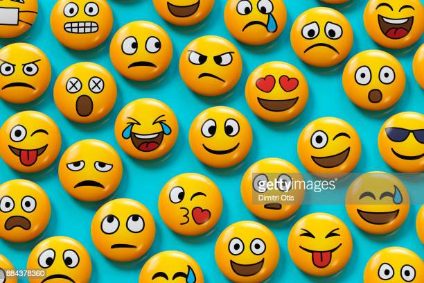 emoji badges on blue background - smiley face stock pictures, royalty-free photos & images