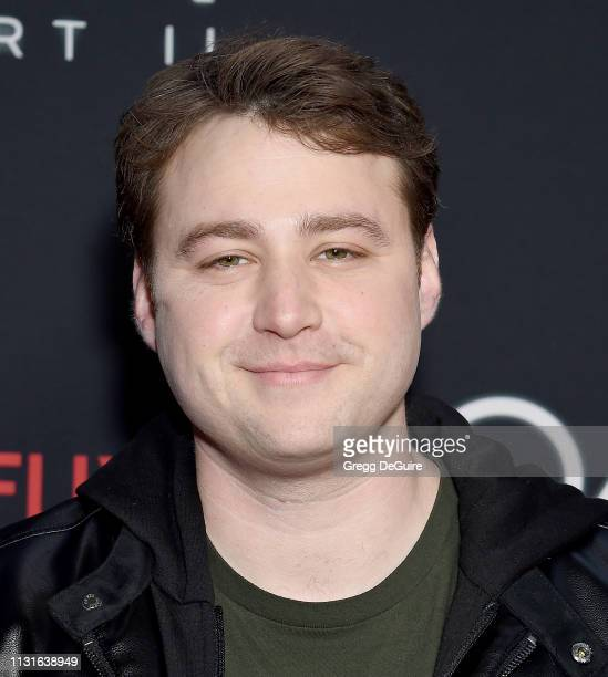 Emory Cohen arrives at Netflix's The OA Part II Premiere at LACMA on March 19 2019 in Los Angeles California