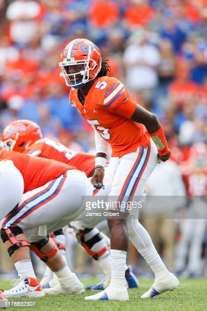 Emory Jones of the Florida Gators directs his teammates during the fourth quarter of a game against the Towson Tigers at Ben Hill Griffin Stadium on...