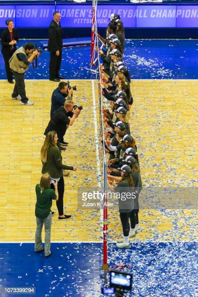 Emory University players cut down the net after winning the Division III Women's Volleyball Championship held at the AJ Palumbo Center on November 17...