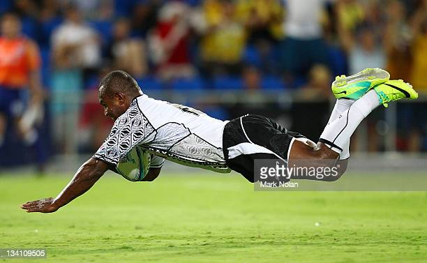 Emosi Vucago of Fiji scores during the Cup Final match between New Zealand and Fiji on day two of the Gold Coast Sevens World Series at Skilled Park...