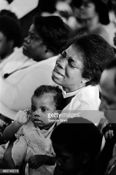 Emotional Africa-American mom at Easter church service in Roxbury, Boston, Massachusetts, 1974.