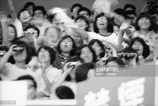 Emotional Beatles fans at the Budokan Hall in Tokyo Japan during the band's tour of Asia 1966