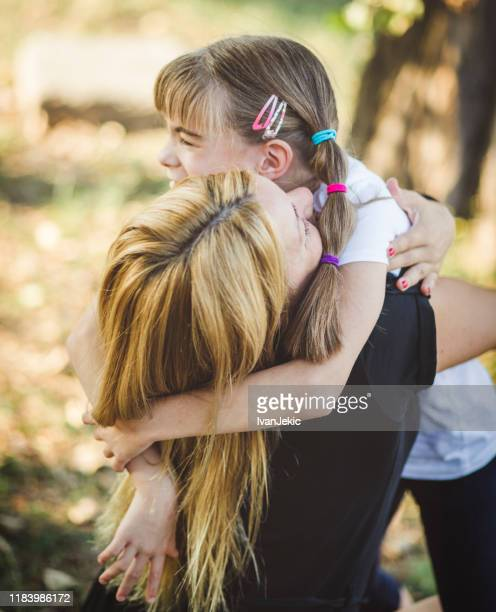emotional family hugging in nature - ivanjekic stock pictures, royalty-free photos & images