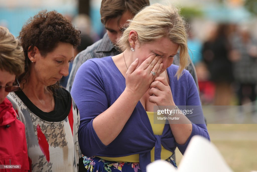 Emotional family members lay flowers during the memorial service marking the second anniversary of the Christchurch Earthquakes on February 22, 2013 in Christchurch, New Zealand. On February 22, 2011, a 6.3 magnitude earthquake hit Christchurch which, along with several aftershocks, killed 185 people.