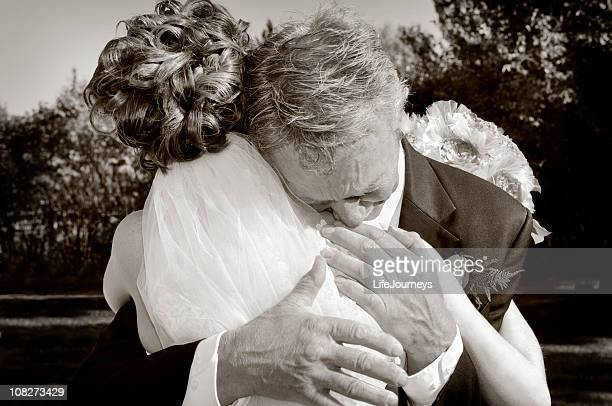 Emotional Father Of The Bride Giving His Daughter A Hug