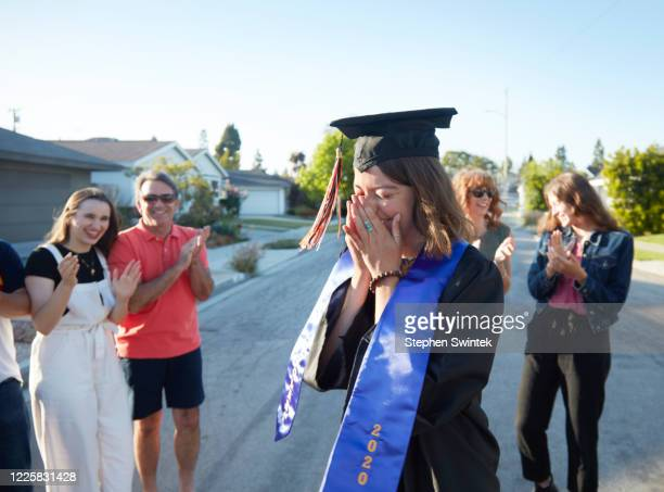 emotional graduation moment - graduation stock pictures, royalty-free photos & images