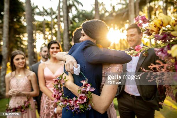 emotional groom being congratulated by the wedding guests - wedding ceremony stock pictures, royalty-free photos & images