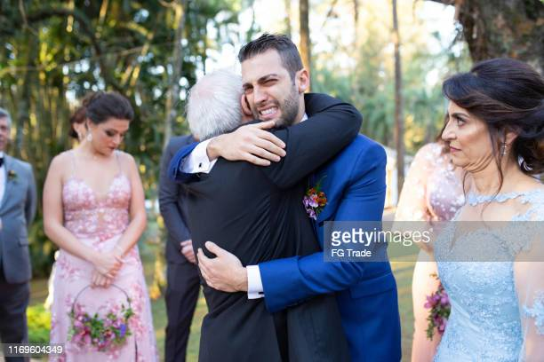 emotional groom being congratulated by the wedding guests - guest stock pictures, royalty-free photos & images