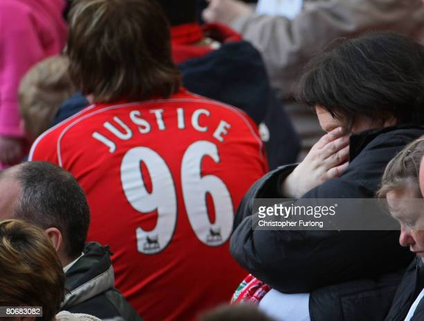 Emotional Liverpool supporters attend a service at Anfield football stadium in Liverpool to mark the 19th anniversary of the Hillsborough disaster on...